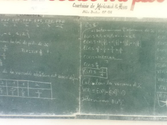 Advanced math on school blackboards.